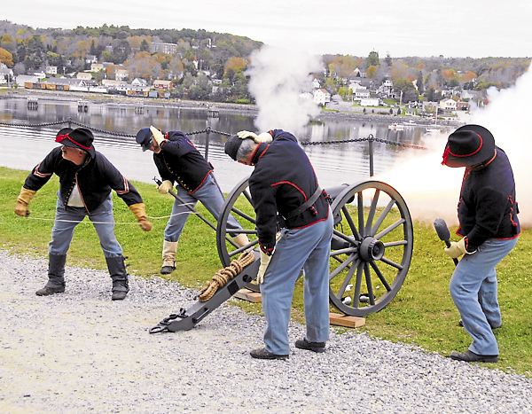 Four members of the Sixth Maine Battery fire a mountain howitzer at Fort Knox State Historic Site. Civil War re-enactors camped outside Fort Knox on Saturday and Sunday and fired two cannons on the hour for several hours each day.