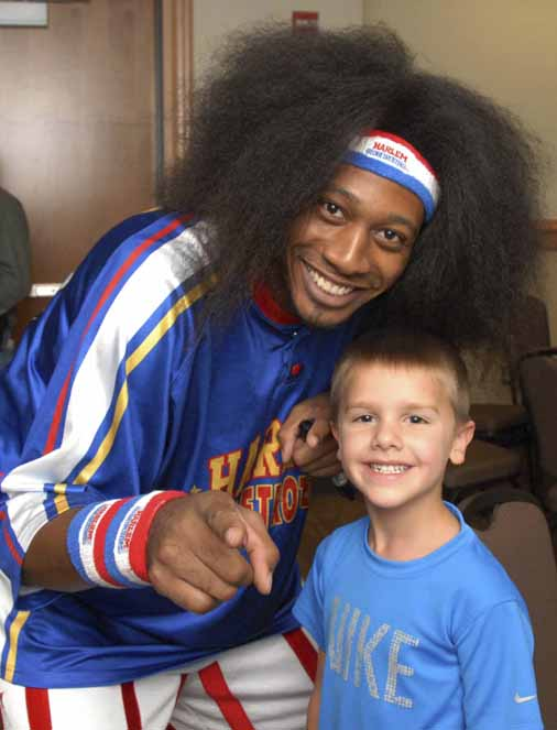 BANGOR, MAINE - Friday, Sept. 20, 2013 - Chase Caron of Bangor smiles as he meets Harlem Globetrotter Alex &quotMoose&quot Weekes prior to Friday's Globetrotter game at the Cross Insurance Center. Caron also met three other Globetrotters after his parents won a contest sponsored by the Bangor Daily News.