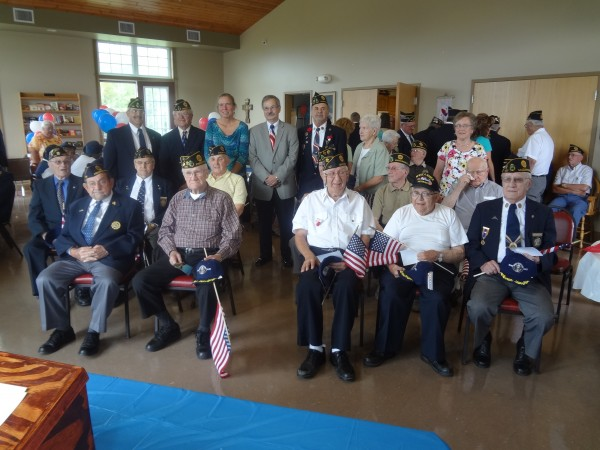 Pictured (standing left to right): Percy Thibeault, Master of Ceremonies; Cliff Guerrette, Commander Post 145; Barbara Haslette, representing US Senator Michael Michaud; Phil Collins, representing US Senator Susan Collins; Joel Cyr, Commander Post 147. World War II Veterans (sitting, second row) Maurice Sirois, Tom Clavette, Robert Michaud, Roland Michaud, Armand Martin, Adrian Cyr; (sitting, front row) Clovis Daigle, Gerard Michaud, Louis Dufour, Nivard Hebert, Clarence Cyr.