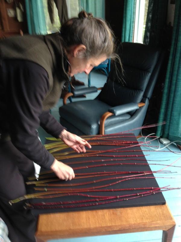 2013 artist Elizabeth Billings weaves dogwood stems.