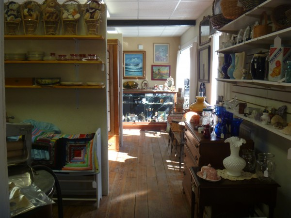 Morning sunlight streams through a window illuminating some of the many wares offered by vendors at the new Hampden Antiques Mall.