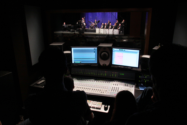New England School of Communications students work the soundboard at a performance on the Husson University campus.