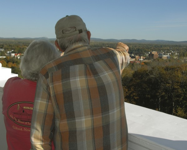 While visiting the Thomas Hill Standpipe on Oct. 9, Colin Fencer of Eddington points out a distant landmark to his wife, Joan.