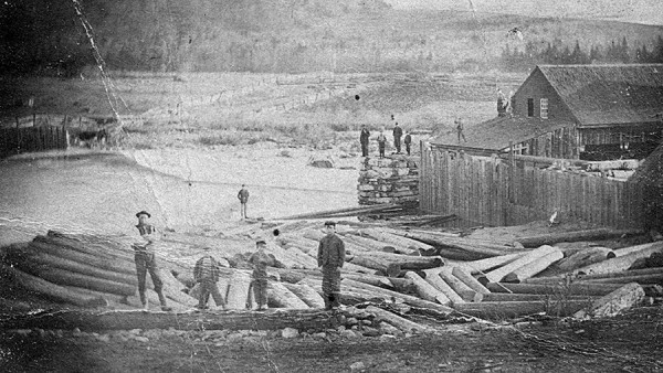 In this circa-1870s photo, men and boys stand on logs, a pier, and even a roof at the Kingfield Mills on the Carrabassett River in Kingfield. The men might have witnessed the July 1863 Kingfield Rebellion — and the efforts by Maine authorities to crush it.