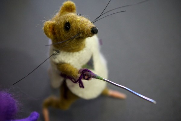 A mouse with sword, made from felted wool, graces Julie Yarbrough's table in the fiber arts building at the Fryeburg Fair Tuesday.