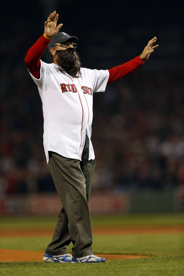 Boston Red Sox former player Carlton Fisk throws out the ceremonial first pitch prior to game six of the World Series against the St. Louis Cardinals at Fenway Park.