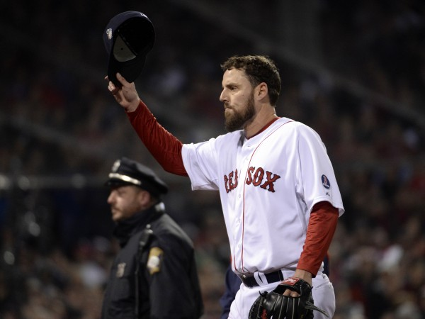 Boston Red Sox starting pitcher John Lackey tips his cap to the crowd as he is relieved in the 7th inning against the St. Louis Cardinals during game six of the World Series at Fenway Park.