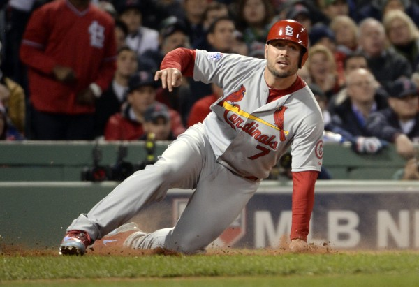 St. Louis Cardinals left fielder Matt Holliday scores a run against the Boston Red Sox in the fourth inning during game two of the World Series at Fenway Park.