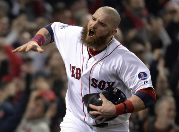 Boston Red Sox left fielder Jonny Gomes celebrates after scoring a run against the St. Louis Cardinals in the third inning during game six of the World Series at Fenway Park.