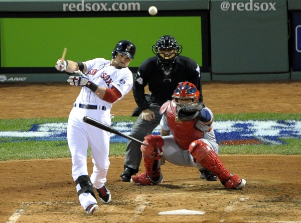 Boston Red Sox center fielder Jacoby Ellsbury breaks his bat as he hits a single against the St. Louis Cardinals in the third inning during game two of the World Series at Fenway Park.