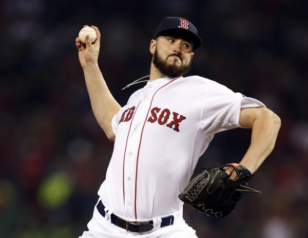 Boston Red Sox relief pitcher Brandon Workman (67) throws against the St. Louis Cardinals during the eighth inning of game six of the World Series at Fenway Park.