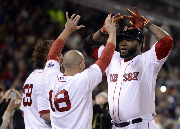 Boston Red Sox designated hitter David Ortiz (right) celebrates with teammate Shane Victorino (18) after hitting a two-run home run against the St. Louis Cardinals in the sixth inning during game two of the World Series at Fenway Park.