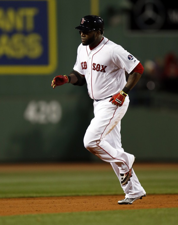 Boston Red Sox designated hitter David Ortiz (34) runs the bases after hitting a 2-run home run against the St. Louis Cardinals during the sixth inning of game two of the MLB baseball World Series at Fenway Park.