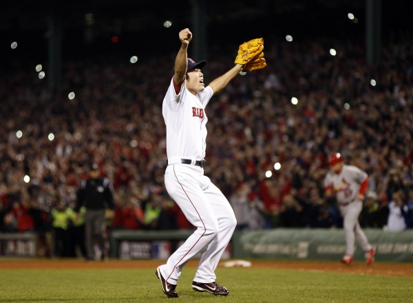 Boston Red Sox relief pitcher Koji Uehara (19) reacts after defeating the St. Louis Cardinals in game six of the World Series at Fenway Park. Red Sox won 6-1.