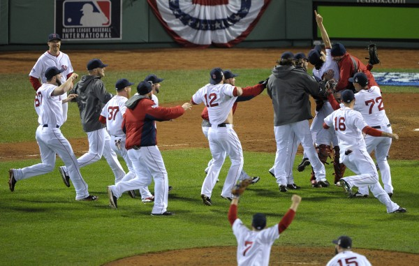 Boston Red Sox players celebrate on the field after game six of the MLB baseball World Series against the St. Louis Cardinals at Fenway Park. The Red Sox won 6-1 to win the series four games to two.