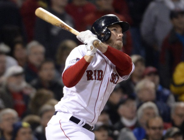 Boston Red Sox shortstop Stephen Drew hits a solo home run against the St. Louis Cardinals in the fourth inning during game six of the World Series at Fenway Park.