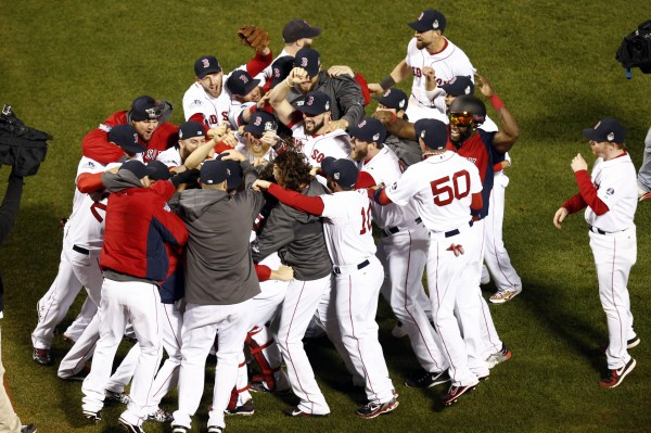 The Boston Red Sox react after defeating the St. Louis Cardinals in game six of the World Series at Fenway Park. Red Sox won 6-1.