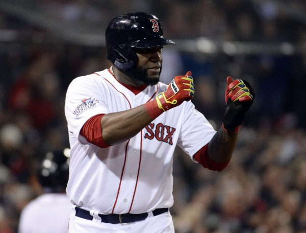 Boston Red Sox designated hitter David Ortiz reacts after scoring in the fourth inning against the St. Louis Cardinals during game six of the World Series at Fenway Park.