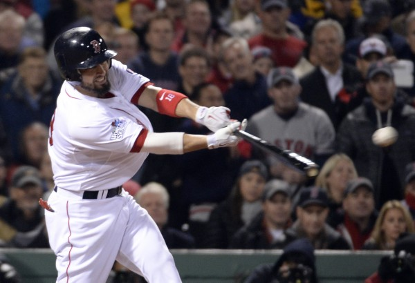 Boston Red Sox right fielder Shane Victorino hits a RBI single against the St. Louis Cardinals in the fourth inning during game six of the World Series at Fenway Park.