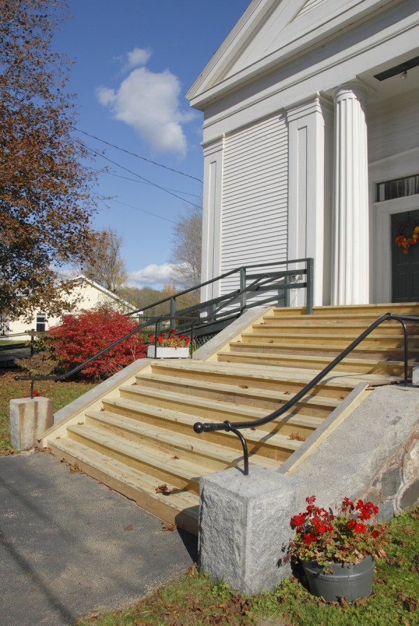 Carpenter Kevin Brassbridge oversaw the construction of 13 new front steps on the Frankfort Congregational Church on Oct. 19. After recently discovering that same steps were rotting, church members sought bids to replace the steps.