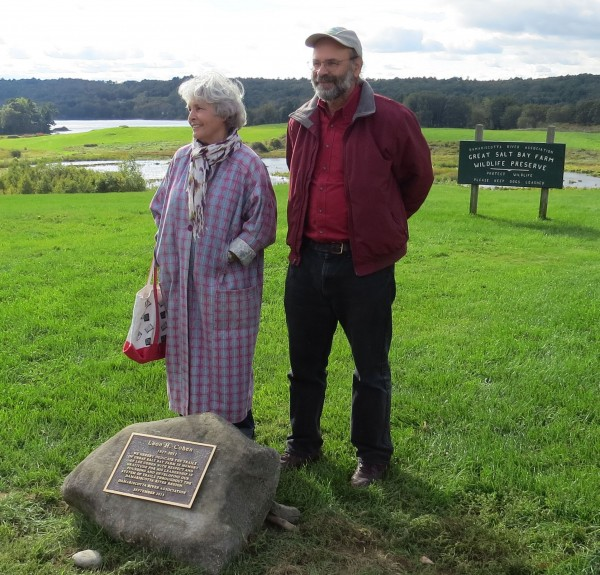 Rhoda Cohen and her son Russ Cohen are pictured with a plaque in memory of Rhoda's husband Lee Cohen, to whom the Damariscotta River Association dedicated the trails of the Great Salt Bay Farm at a September 24 ceremony.