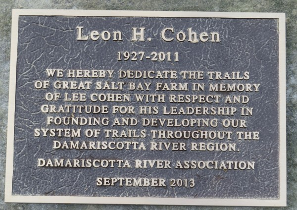 A plaque at the Damariscotta River Association's Great Salt Bay Farm remembers Lee Cohen, a builder and supporter of trails throughout the Damariscotta River region and far beyond. It was unveiled on September 24 at a ceremony with DRA leaders and Lee's friends and family.