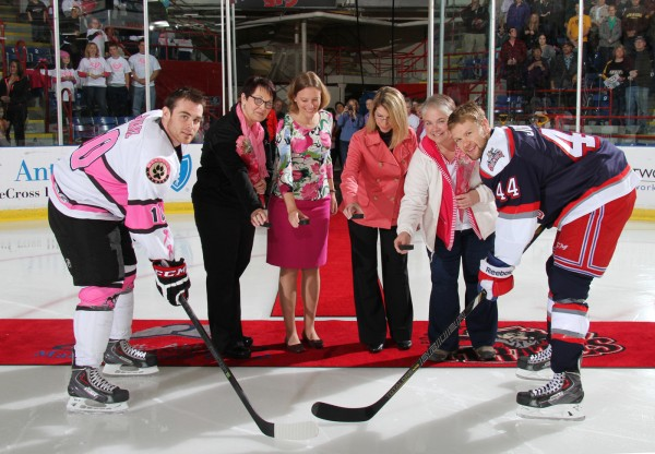 Pirates Captain Jordan Szwarz and Wolf Pack Captain Aaron Johnson helped with the ceremonial puck drop before the start of the game. Dr. Nicholette Erickson, a medical oncologist and director of the Central Maine Medical Center's comprehensive cancer program, and Dr. Courtney Jensen, a radiation oncologist and medical director of radiation oncology at Central Maine Medical Center joined survivors Darlene Molboski and Carlene Sperry to a loud ovation from Pirates fans at the Colisee.