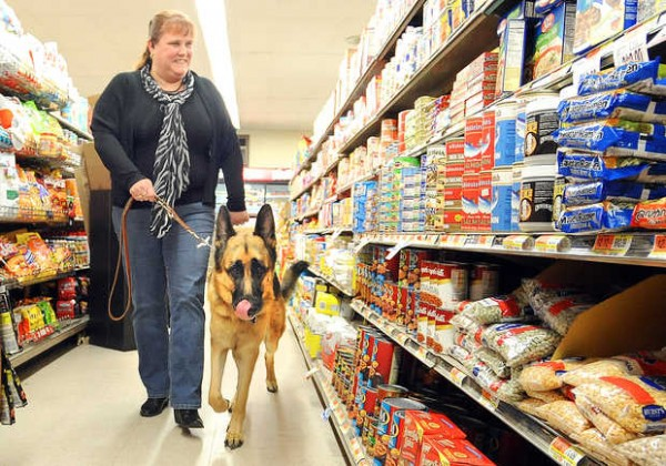 Leanne Nelson and her guide dog, Ozzie, shop at Bourque's Market on Sabattus Street in Lewiston on Friday.
