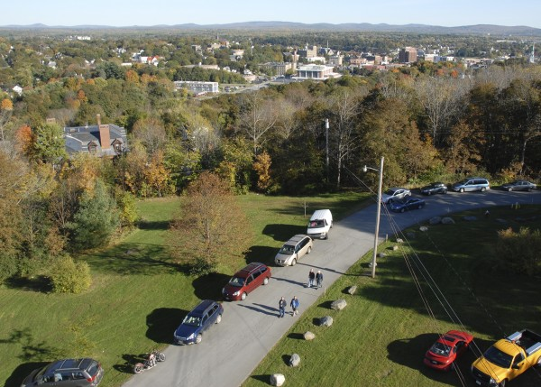 Parked vehicles line one side of Thomas Hill Road as visitors walk toward the Thomas Hill Standpipe on Oct. 9. Sponsored by the Bangor Water District, an open house drew 1,325 people to climb the steps to the standpipe's observation deck.