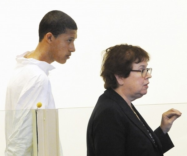 Philip Chism, 14, stands during his arraignment for the death of Danvers High School teacher Colleen Ritzer in Salem District Court in Boston, Mass., Oct. 23, 2013 as his attorney Denise Regan (right) speaks on his behalf.