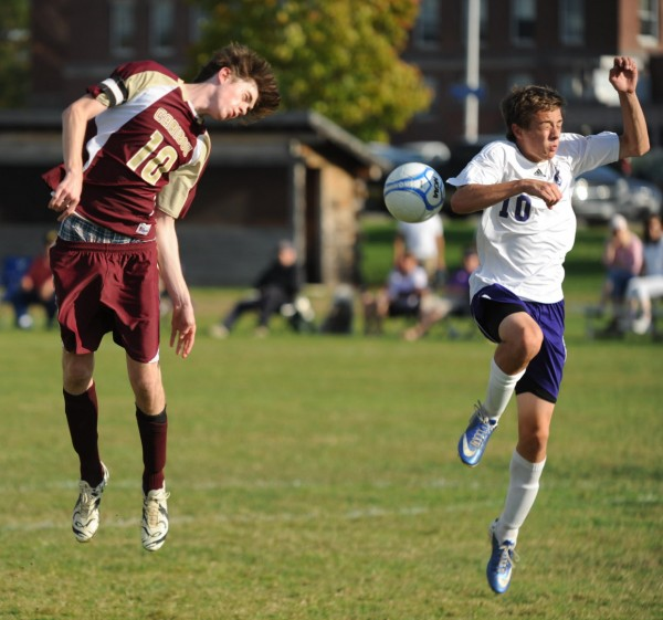 Caribou's Kamerson Manter heads the ball towards the goal  and John Bapst's Justin Gagnon during first half action on Tuesday at Bangor.