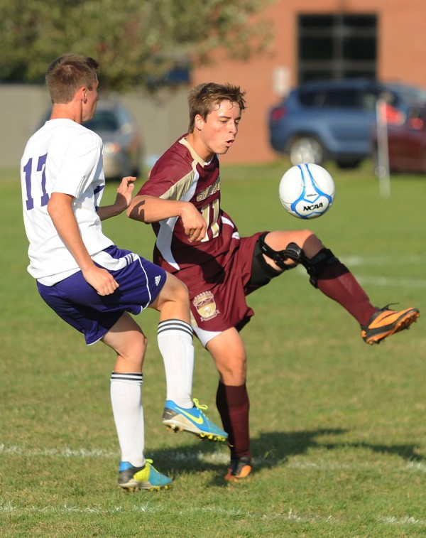 Caribou's Adam Collins and John Bapst's Braydon Norris battle for control of the ball during first half action on Tuesday at Bangor.