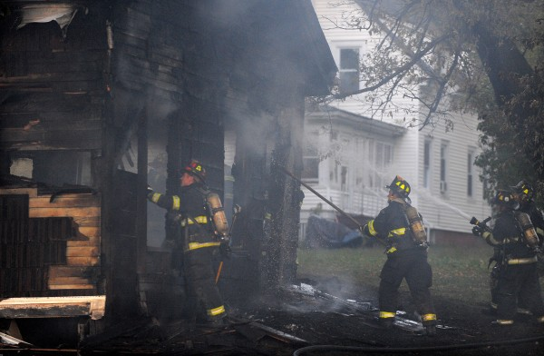 Firefighters hit hotspots on a structure that caught fire on Buck Street in Bangor Tuesday evening.