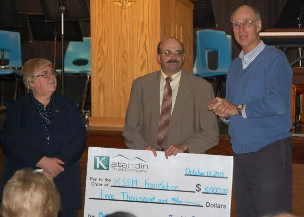 Attached image: L-R Rena Bouchard, Vice President and Manager of the Limestone and Van Buren branches of Katahdin Trust Company and Craig Staples, Vice President and Commercial Services Officer at Katahdin Trust Company present a donation check to Art Thompson MSSM Foundation Board of Directors Chair.