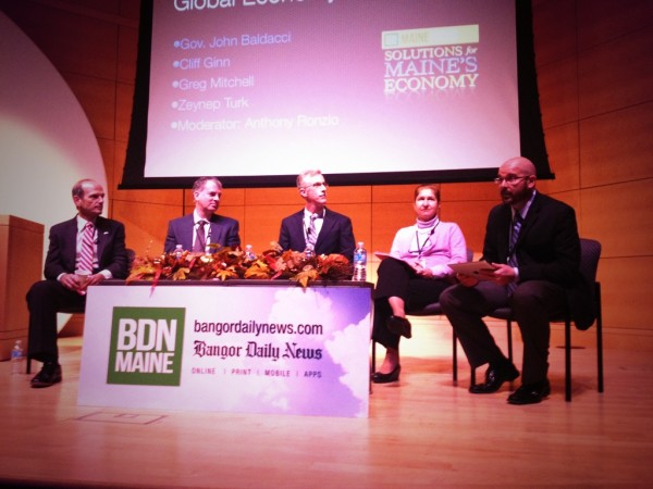 BDN Director of News and Audience Anthony Ronzio (right) moderates a panel at MaineFocus: Solutions for Maine's Economy at USM in Portland Wednesday. Speaking were former Maine Gov. John Baldacci (from left), Cliff Ginn, Greg Mitchell and Zeynep Turk.