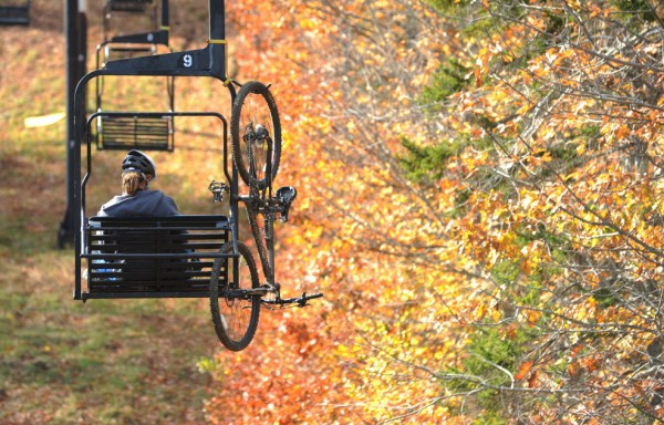 Jared Palmer of Thorndike rides the chair lift at the Camden Snow Bowl on Sunday to ride his mountain bike down the custom built bike trails. On Nov. 5 voters will decide if the town should borrow $2 million to allow for a package of major improvements to the town-owned recreation area.