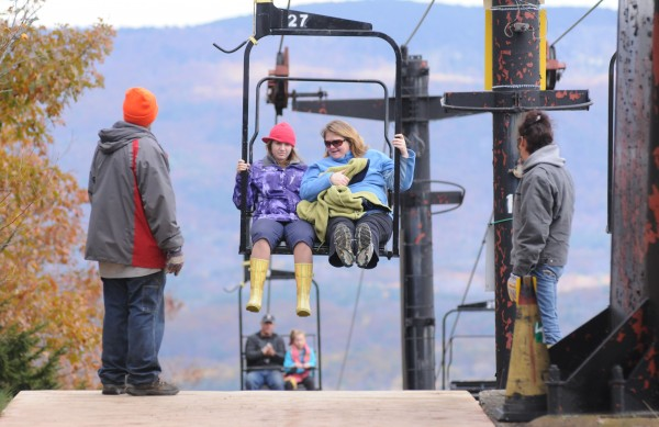 Lift attendants assist hikers Caryln Willis and her daughter Annie as they use the antiquated ski lift installed in 1975 at the Camden Snow Bowl on Sunday.