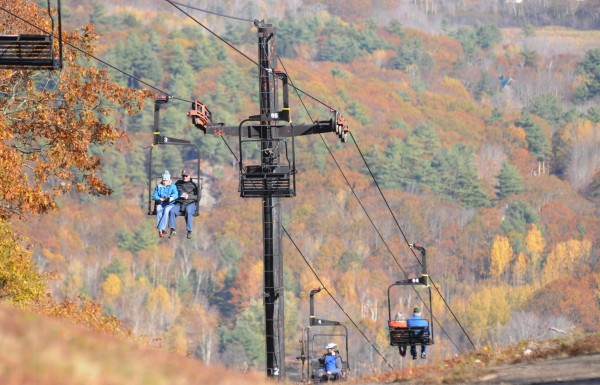 Hikers, bikers and those interested in seeing the fall colors from Ragged Mountain in Camden use the antiquated ski lift installed in 1975 at the Camden Snow Bowl on Sunday. On Nov. 5 voters will decide if the town should borrow $2 million to allow for a package of major improvements to the town-owned recreation area. The redevelopment of the Snow Bowl calls for new ski lifts, an expanded beginners ski area, improved parking, new snowmaking equipment and a new, larger lodge.