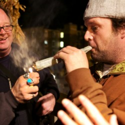 "Writer Crash Barry (left) and Frank Rizzo of Bethel light up a joint at the ""Yes on 1"" headquarters in Portland on Tuesday night after declaring victory in a referendum to legalize recreational use of marijuana in the city."