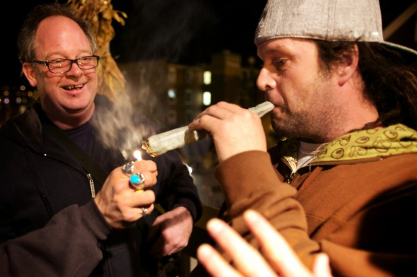 Writer Crash Barry (left) and Frank Rizzo of Bethel light up a joint at the &quotYes on 1&quot headquarters in Portland on Tuesday night after declaring victory in a referendum to legalize recreational use of marijuana in the city.