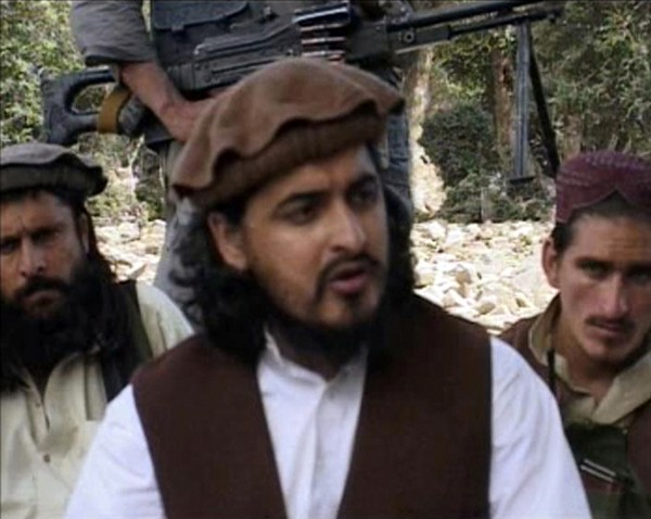 Pakistani Taliban chief Hakimullah Mehsud sits with other militants in South Waziristan, in this file still image taken from video shot Oct. 4, 2009.