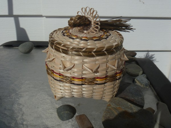 This Honor Basket is a specialty of Penobscot basket maker Pam Cunningham of Hampden. The idea for the basket came to her in a dream approximately 15 years ago.