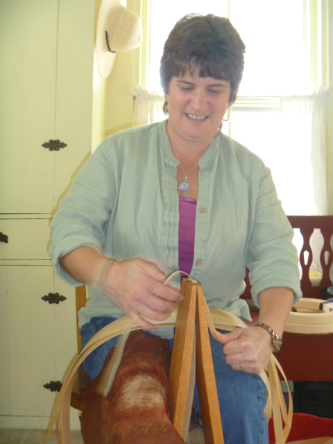 Penobscot basket maker Pam Cunningham of Hampden splits brown ash in her kitchen recently.
