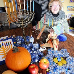 Bertha Bodenheimer, left, and Leslie Weiner pose with some of their family decorations for both Thanksgiving and Hanukkah at Temple Shalom in Auburn Sunday. This year Thanksgiving and Hanukkah align, a phenomenon that may not happen again for more than 70,000 years.