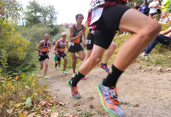 Runners negotiate the course during the boys seeded race of the 2013 Festival of Champions cross country races in Belfast on Oct. 5.