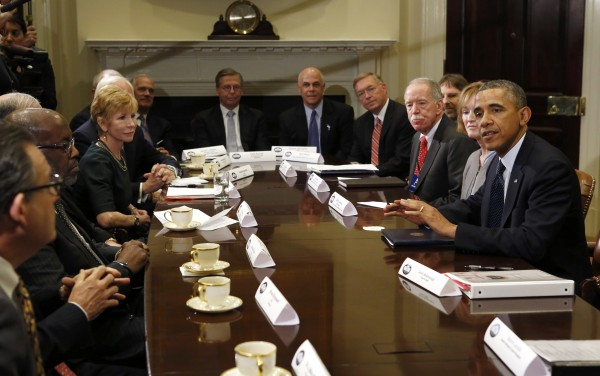President Barack Obama meets with health insurance chief executives at the White House in Washington on Nov. 15, 2013.