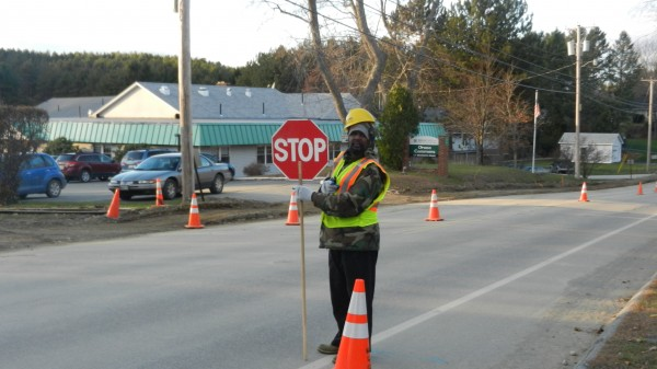 Photo showing safety zone set up on Bennoch Road on Tuesday, Nov. 12, 2013. The flagger's name is Claude Imedka. He moved to Maine from Congo.