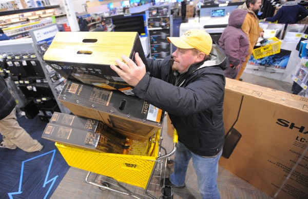 Ted Robertson of Sussex, New Brunswick bought three televisions and three printers during the Black Friday sale at Best Buy in Bangor Thursday night.