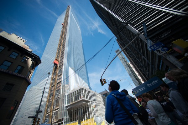 Pedestrians look up at the 4 World Trade Center building in New York in September. The first skyscraper at lower Manhattan's World Trade Center opens Wednesday with two days of ceremonies.