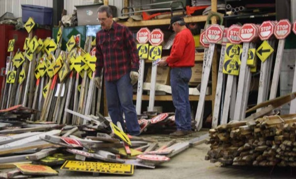 Maynard Plourde, a volunteer with the Caribou Snowmobile Club, gazes over a sea of signage during one of the club's work nights on Nov. 14, sizing up the pile like a giant game of pick-up-sticks. A lot of work goes into preparing the signs  -- including painting, sorting, cutting and sawing -- before the sledding season begins.
